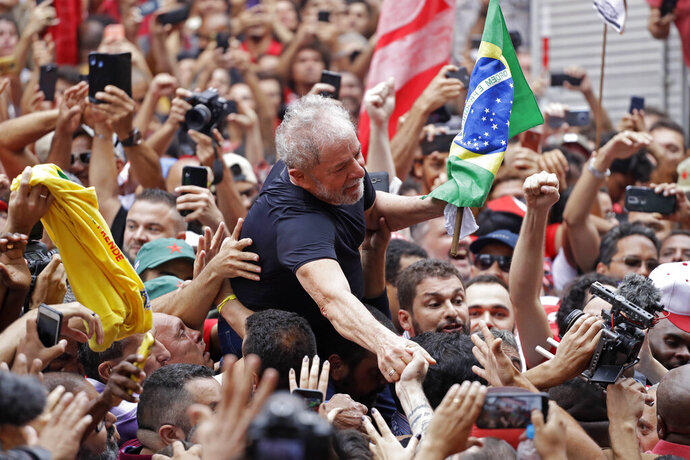 Former Brazilian President Luiz Inacio Lula da Silva is carried by supporters during a rally at the Metal Workers Union headquarters, in Sao Bernardo do Campo, Brazil, Saturday, Nov. 9, 2019. Da Silva addressed thousands of jubilant supporters a day after being released from prison.