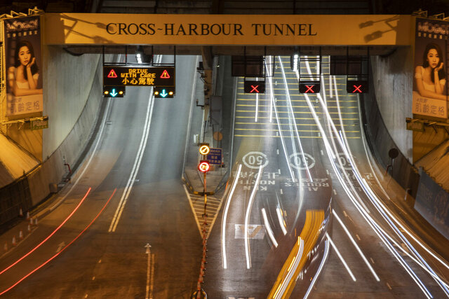 Traffic flows through the Cross-Harbor Tunnel which reopens in Hong Kong on Wednesday, Nov. 27, 2019. Closed by protesters who took over the neighboring Hong Kong Polytechnic University, the tunnel reopens after authorities repaired the damages caused. (AP Photo/Ng Han Guan)