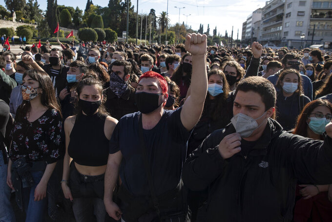 University students wearing face masks to protect against coronavirus, chant slogans as they take part in a rally against education reforms in Athens, Thursday, Feb. 4, 2021. Thousands of protesters in Greece have held demonstrations in the Greek capital and the second largest city of Thessaloniki against plans by the government to police university campuses. (AP Photo/Petros Giannakouris)