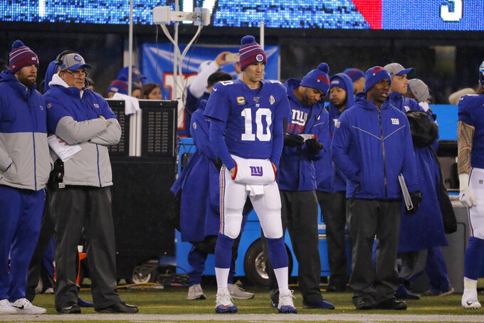 New York Giants quarterback Eli Manning (10) watches from the sidelines in the first half of an NFL football game against the Philadelphia Eagles, Sunday, Dec. 29, 2019, in East Rutherford, N.J. (AP Photo/Seth Wenig)