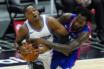 Los Angeles Clippers guard Patrick Beverley, right, defends against Sacramento Kings guard De'Aaron Fox during the first quarter of an NBA basketball game Wednesday, Jan. 20, 2021, in Los Angeles. (AP Photo/Ashley Landis)