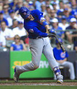 FILE - In this Sept. 24, 2017, file photo, Chicago Cubs third baseman Kris Bryant hits an RBI-double against the Milwaukee Brewers during the fourth inning of an baseball game in Milwaukee. The hot corner figures to be smoking Friday, Jan. 12, 2018, when players and team swap proposed salaries in arbitration. Toronto's Josh Donaldson, Baltimore's Manny Machado, Washington's Anthony Rendon and Bryant were among the more than 170 players headed to the exchange. (AP Photo/Darren Hauck, File)