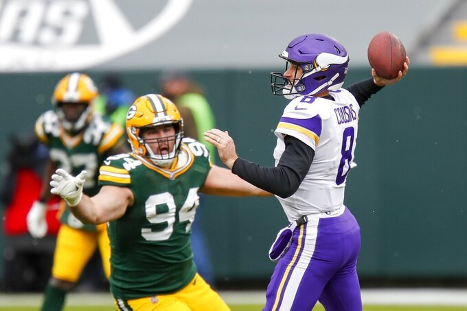 Minnesota Vikings' Kirk Cousins throws with Green Bay Packers' Dean Lowry rushing during the first half of an NFL football game Sunday, Nov. 1, 2020, in Green Bay, Wis. (AP Photo/Matt Ludtke)
