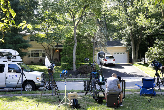 FILE- In this July 20, 2020 file photo, news media is set up in front of the home of U.S. District Judge Esther Salas in North Brunswick, N.J. New Jersey Gov. Phil Murphy has signed a bill into law on Friday, Nov. 20 that protects the personal information of judges and other law enforcement personnel from being publicly available. The law is named after Daniel Anderl, the son of U.S. District Judge Esther Salas who was slain at the family's home by a disgruntled attorney who had targeted Salas and other judges. (AP Photo/Mark Lennihan, File)