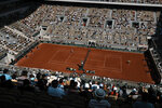 The crowd watch Spain's Rafael Nadal playing Argentina's Diego Schwartzman during their quarterfinal match of the French Open tennis tournament at the Roland Garros stadium Wednesday, June 9, 2021 in Paris. (AP Photo/Thibault Camus)