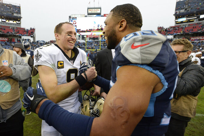 New Orleans Saints quarterback Drew Brees (9) talks with Tennessee Titans inside linebacker Wesley Woodyard (59) after an NFL football game Sunday, Dec. 22, 2019, in Nashville, Tenn. The Saints won 38-28. (AP Photo/Mark Zaleski)