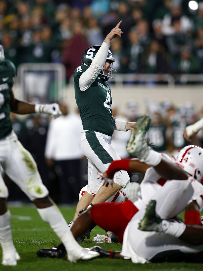 Michigan State's Matt Coghlin, center, celebrates as he watches the winning field goal against Nebraska during overtime of an NCAA college football game, Saturday, Sept. 25, 2021, in East Lansing, Mich. (AP Photo/Al Goldis)