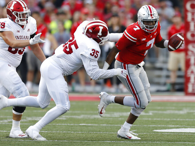 Ohio State quarterback Dwayne Haskins, right, scrambles away from Indiana defensive lineman Nile Sykes during the second half of an NCAA college football game Saturday, Oct. 6, 2018, in Columbus, Ohio. (AP Photo/Jay LaPrete)