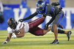 Kentucky defensive back Carrington Valentine (14) tackles South Carolina running back Kevin Harris (20) during the first half of an NCAA college football game Saturday, Dec. 5, 2020, in Lexington, Ky. (AP Photo/Bryan Woolston)