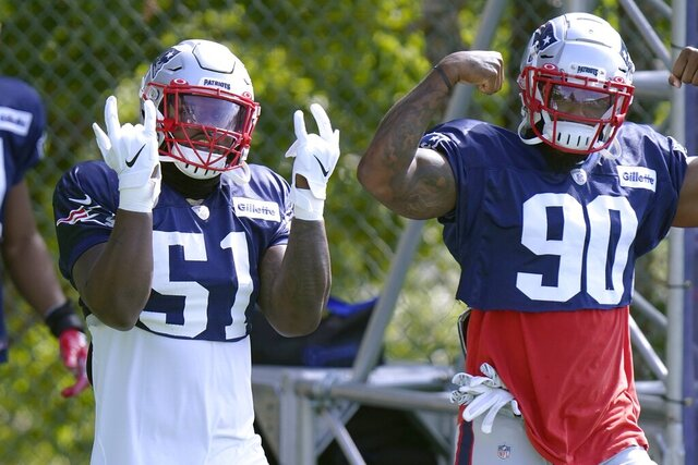New England Patriots linebackers Ja'Whaun Bentley (51) and Shilique Calhoun (90) step onto the field for an NFL football training camp practice, Monday, Aug. 24, 2020, in Foxborough, Mass. (AP Photo/Steven Senne, Pool)