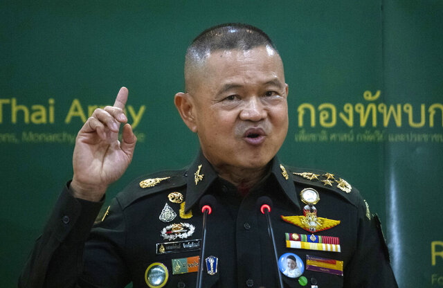 Thailand Army Chief Gen. Narongpan Jittkaewtae speaks during press briefing at the Thai Army headquarters in Bangkok, Thailand, Tuesday, Oct. 6, 2020. Narongpan, 57, held his first press conference since becoming army commander on Oct. 1, and made the traditional pledge to defend country, the Buddhist religion, the monarchy and the people, but seemed to take a softer line than his predecessor toward a student-led anti-government protest movement. (AP Photo/Sakchai Lalit)