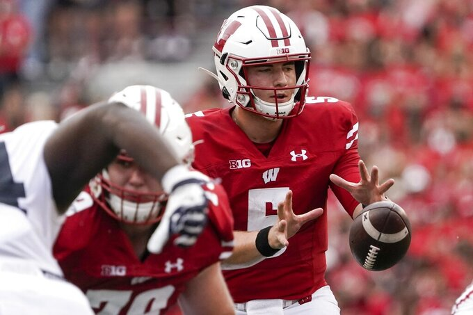 Wisconsin's Graham Mertz takes a snap during the first half of an NCAA college football game against Penn State Saturday, Sept. 4, 2021, in Madison, Wis. (AP Photo/Morry Gash)