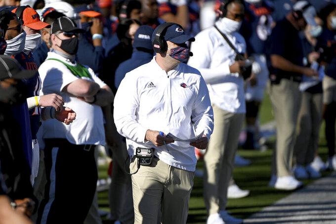 UTSA offensive coordinator Barry Lunney Jr., filling in as coach after Jeff Traylor tested positive for COVID-19, watches from the sideline during the first quarter of the team's First Responder Bowl NCAA college football game against Louisiana-Lafayette in Dallas, Saturday, Dec. 26, 2020. (AP Photo/Matt Strasen)