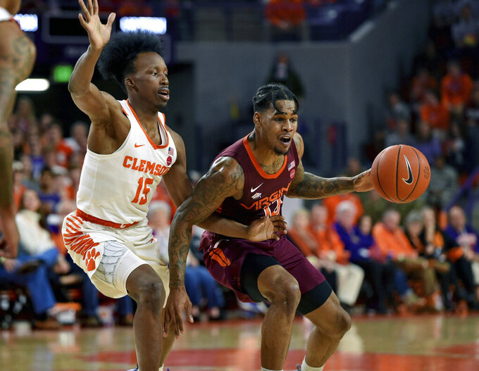 Virginia Tech's Ahmed Hill drives against Clemson's John Newman III (15) during the first half of an NCAA college basketball game Saturday, Feb. 9, 2019, in Clemson, S.C.. (AP Photo/Richard Shiro)