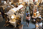 Melissa Schneider, rear, of Wappingers Falls, N.Y., and her mother, Bernadette Hunlock, of Hawley, Pa., shop at Hawley Antique Exchange in Hawley, Pa., Friday, May 22, 2020. Many Wayne County businesses opened on Friday for the first time since March as the county moved to the yellow phase of reopening after the COVID-19 shutdown of non-essential businesses. (Christopher Dolan/The Times-Tribune via AP)