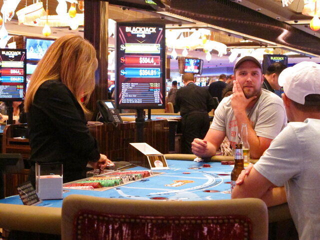 This June 20, 2019 photo shows a card game underway at the Hard Rock casino in Atlantic City N.J. Figures released on April 15, 2020 show New Jersey's March casino and sports betting revenue fell to $163 million in March, down over 44% from a year ago as half the month was wiped out by virus-related closures. Indiana, Maryland and Michigan casinos fared even worse in March. (AP Photo/Wayne Parry)