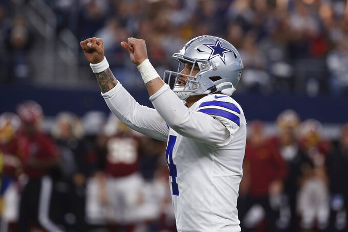 Dallas Cowboys quarterback Dak Prescott (4) celebrates a touchdown during the first half of an NFL football game against the Washington Redskins in Arlington, Texas, Sunday, Dec. 15, 2019. (AP Photo/Ron Jenkins)