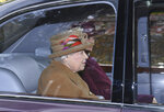 """Britain's Queen Elizabeth II arrives to attend a morning church service at St Mary Magdalene Church in Sandringham, England, Sunday Jan. 12, 2020.   Prince Harry and his wife Meghan have declared they will """"work to become financially independent"""" as part of a surprise announcement saying they wish"""