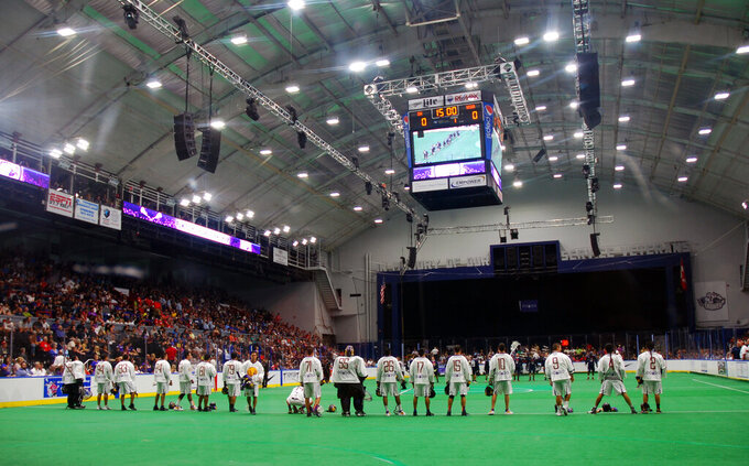 This Sept. 18, 2015 photo shows the Iroquois Nationals lacrosse team line up prior to competing in the 2015 World Indoor Lacrosse Championships on the Onondaga Nation just south of Syracuse, N.Y. The Ireland Lacrosse team recently bowed out of the sport's top international tournament to open up a spot for the Iroquois Nationals. It's the latest in a series of gestures between the country and U.S. tribes that date back to 1847, when Choctaw leaders gave $170 to the Irish as their country battled a potato famine that resulted in the death of tens of thousands. Historians estimate today's value of the amount at roughly $5,000. (Jourdan Bennett-Begaye, Indian Country Today via AP)