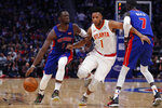 Detroit Pistons guard Reggie Jackson (1) drives as Atlanta Hawks guard Evan Turner (1) defends during the first half of an NBA basketball game Thursday, Oct. 24, 2019, in Detroit. (AP Photo/Carlos Osorio)