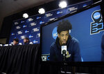 Murray State's Ja Morant is displayed on a monitor as he and teammate Shaq Buchanan speak during a news conference at the NCAA men's college basketball tournament, Friday, March 22, 2019, in Hartford, Conn. Murray State face Florida State in the second round on Saturday. (AP Photo/Elise Amendola)