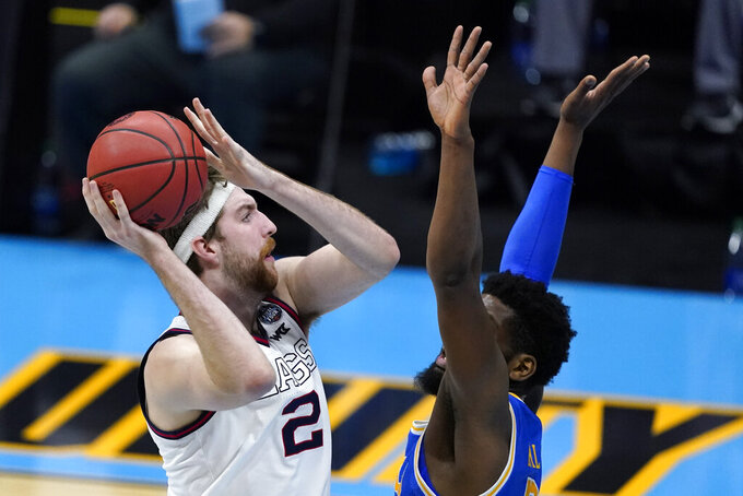 Gonzaga forward Drew Timme, left, shoots over UCLA forward Cody Riley, right, during the first half of a men's Final Four NCAA college basketball tournament semifinal game, Saturday, April 3, 2021, at Lucas Oil Stadium in Indianapolis. (AP Photo/Darron Cummings)