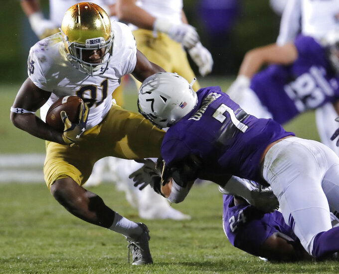 Notre Dame's Miles Boykin, left, is tackled by Northwestern's Travis Jack Whillock during the second half of an NCAA college football game Saturday, Nov. 3, 2018, in Evanston, Ill. (AP Photo/Jim Young)
