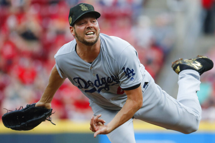 Los Angeles Dodgers starting pitcher Rich Hill throws in the second inning of a baseball game against the Cincinnati Reds, Friday, May 17, 2019, in Cincinnati. (AP Photo/John Minchillo)
