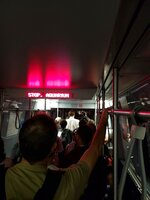 In this photo provided by Ryan Mahan, passengers on a Blue Line train caught in a power outage having to walk through the subway tunnels in Boston, Mass., Thursday, Aug. 9, 2018, after a power outage. A spokesman for the Massachusetts Bay Transportation Authority says about 350 passengers were escorted out of a Blue Line tunnel on Thursday morning by transit police and city firefighters. None of the passengers requested medical attention. The T offered shuttle buses between affected stations. (Ryan Mahan via AP)