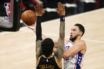 Philadelphia 76ers' Ben Simmons, right, shoots against Atlanta Hawks' John Collins, left, during the first half of Game 4 of a second-round NBA basketball playoff series on Monday, June 14, 2021, in Atlanta. (AP Photo/Brynn Anderson)