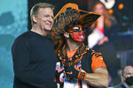 NFL Commissioner Roger Goodell and a Cincinnati Bengals fan pose for a photo during the fourth round of the NFL football draft, Saturday, May 1, 2021, in Cleveland. (AP Photo/David Dermer)
