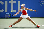 FILE - In this Aug. 3, 2019, file photo, Caty McNally returns the ball during a semifinal match against Camila Giorgi, of Italy, at the Citi Open tennis tournament in Washington. McNally, who is only 17, teamed with Coco Gauff to win the U.S. Open junior doubles title a year ago and again to win a WTA doubles title at the Citi Open this August. Like Gauff, McNally received a wild-card invitation for the main draw of the U.S. Open, which starts next week. (AP Photo/Patrick Semansky, File)
