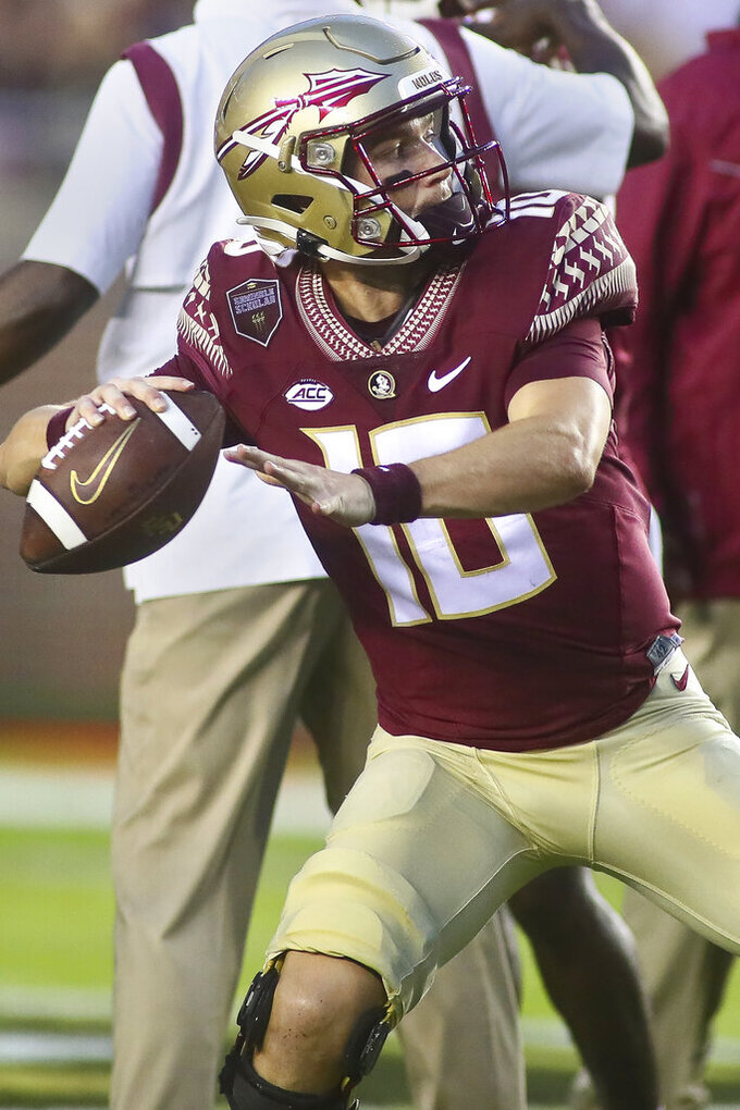 Florida State quarterback McKenzie Milton (10) throws a pass before the start of an NCAA college football game against Jacksonville State Saturday, Sept. 11, 2021, in Tallahassee, Fla. (AP Photo/Phil Sears)