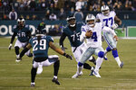 Dallas Cowboys quarterback Dak Prescott (4) runs with the ball as Philadelphia Eagles' Avonte Maddox (29) and Vinny Curry (75) try to stop him during the first half of an NFL football game Sunday, Dec. 22, 2019, in Philadelphia. (AP Photo/Chris Szagola)