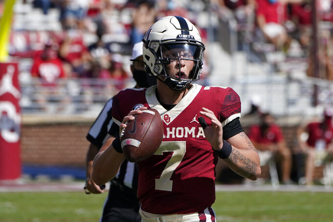 Oklahoma quarterback Spencer Rattler (7) prepares to pass in the first half of an NCAA college football game against Kansas State Saturday, Sept. 26, 2020, in Norman, Okla. (AP Photo/Sue Ogrocki).