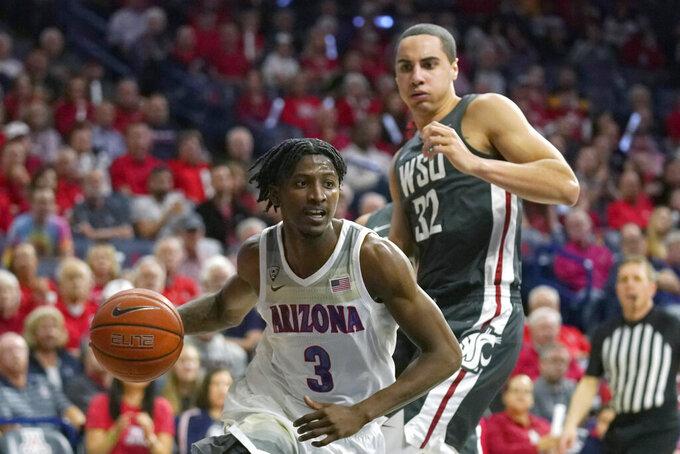 Arizona guard Dylan Smith (3) drives past Washington State forward Tony Miller during the second half of an NCAA college basketball game Thursday, March 5, 2020, in Tucson, Ariz. Arizona won 83-62. (AP Photo/Rick Scuteri)