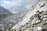 Tourist guide Suresh Panwar navigates icy rocks as he descends a steep mountain ridge in the backdrop of the Bhagirathi peaks and the huge expanse of the Gangotri glacier at an altitude of 4500 meters in the northern Indian state of Uttarakhand, Saturday, May 11, 2019. Bhagirathi peaks feed the Gangotri Glacier which is one of the primary sources of water for the Ganges. This glacier has provided enough water to the arid plains it flows through, even during the driest months. Available data shows that Gangotri Glacier is receding at a frightening pace. (AP Photo/Altaf Qadri)