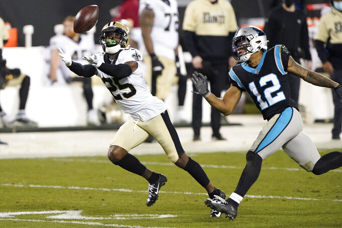 New Orleans Saints Ken Crawley intercepts a pass intended for Carolina Panthers wide receiver D.J. Moore during the second half of an NFL football game Sunday, Jan. 3, 2021, in Charlotte, N.C. (AP Photo/Brian Blanco)