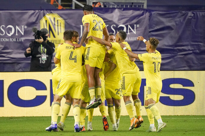 Nashville SC players celebrate a goal against Inter Miami during the second half of an MLS soccer playoff match Friday, Nov. 20, 2020, in Nashville, Tenn. (AP Photo/Mark Humphrey)