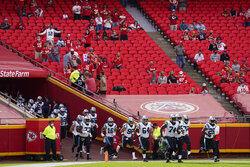 Fans watch as Carolina Panthers players run out of the tunnel at Arrowhead Stadium before an NFL football game between the Kansas City Chiefs and the Panthers in Kansas City, Mo., Sunday, Nov. 8, 2020. (AP Photo/Jeff Roberson)