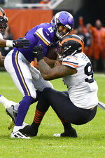 Minnesota Vikings quarterback Kirk Cousins (8) is sacked by Chicago Bears defensive end Roy Robertson-Harris during the second half of an NFL football game Sunday, Sept. 29, 2019, in Chicago. (AP Photo/Matt Marton)