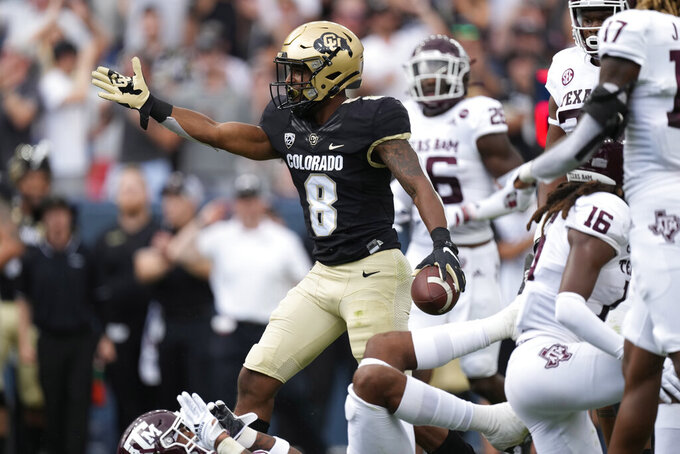 Colorado running back Alex Fontenot reacts after rushing for a first down against Texas A&M in the first half of an NCAA college football game Saturday, Sept. 11, 2021, in Denver. (AP Photo/David Zalubowski)