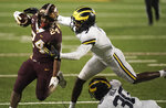 Minnesota running back Mohamed Ibrahim (24) runs for a touchdown against Michigan defensive back Makari Paige (7) in the first half of an NCAA college football game Saturday, Oct. 24, 2020, in Minneapolis. (Mark Vancleave/Star Tribune via AP)