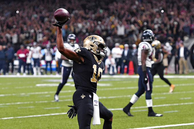 New Orleans Saints wide receiver Tre'Quan Smith (10) celebrates his touchdown reception in the second half of an NFL football game against the Houston Texans in New Orleans, Monday, Sept. 9, 2019. (AP Photo/Bill Feig)