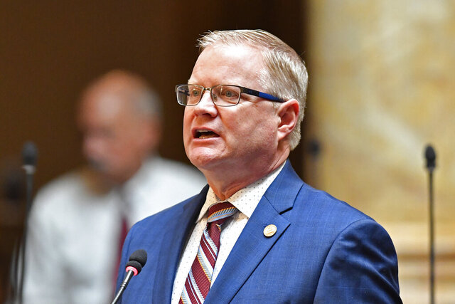FILE - In this Jan. 7, 2020 file photo Kentucky Senate Majority floor Leader Damon Thayer, addresses the members of the Senate during the opening session of the Kentucky State Legislature in Frankfort, Ky. Reconvening after a weeklong break, Kentucky lawmakers worked on a coronavirus-relief measure Thursday, March 26, 2020 to help cushion workers and employers from economic damage caused by the pandemic. (AP Photo/Timothy D. Easley, file)