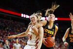 FILE - In this Dec. 11, 2019, file photo, Iowa State guard Ashley Joens, left, battles with Iowa forward Amanda Ollinger during the second half of an NCAA college basketball game, in Ames, Iowa. Big 12 leading scorer Ashley Joens mixes toughness with her knack for putting the basketball in the hoop. (AP Photo/Charlie Neibergall, File)