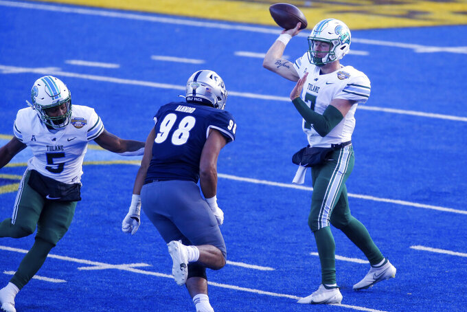 Tulane quarterback Michael Pratt (7) throws a pass as Nevada defensive end Sam Hammond (98) pressures during the first half of the Idaho Potato Bowl NCAA college football game, Tuesday, Dec. 22, 2020, in Boise, Idaho. (AP Photo/Steve Conner)