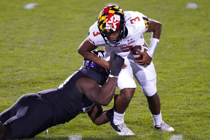 Maryland quarterback Taulia Tagovailoa is sacked by Northwestern defensive line Adetomiwa Adebawore during the second half of an NCAA college football game in Evanston, Ill., Saturday, Oct. 24, 2020. (AP Photo/Nam Y. Huh)
