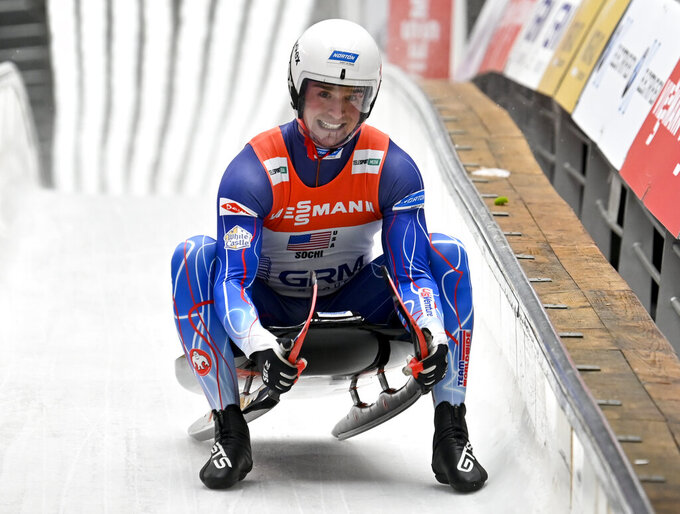 FILE - In this Feb. 16, 2020, file photo, Tucker West, of United States, finishes his team relay race at the World Luge Championships in Krasnaya Polyana, near the Black Sea resort of Sochi, southern Russia. The USA Luge Olympic veteran got the first run down the ice at Mount Van Hoevenberg in Lake Placid, N.Y., on Thursday, Oct. 14, 2021, when the Americans' home track opened for the season. (AP Photo/Artur Lebedev, File)