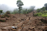 A view of the debris after a landslide stuck early Sunday in Sindhupalchowk district, about 120 kilometers (75 miles) east of the capital, Kathmandu, Nepal, Monday, Sept.14, 2020. Rescuers resumed searching on Monday for people missing since a deadly landslide struck three villages in Nepal's mountains, authorities said. (AP Photo/Niroj Chaulagai)